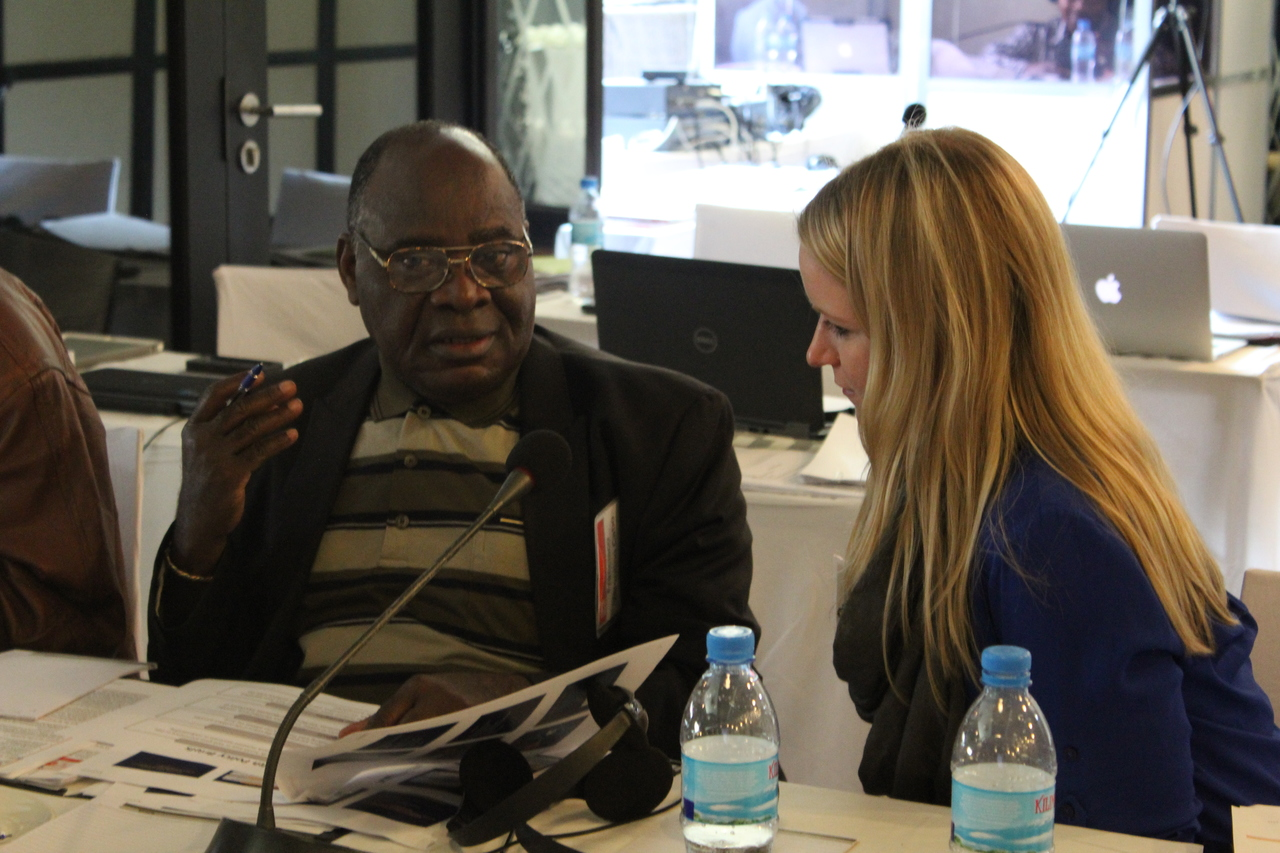 ORISE Fellow, Angela Tripp and workshop participant Francisco Valentino Cabo from Mozambique discuss how to use tobacco prevalence data from his country to develop a tobacco control brief.
