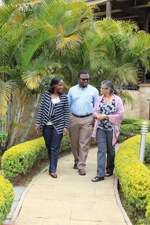 Neema Camara discusses tobacco control in Tanzania with colleague Rogath Kishimba and Indu Ahluwalia.